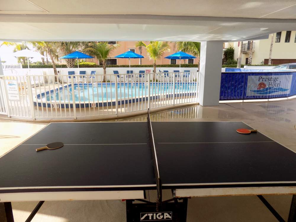 Pool table near gated swimming pool